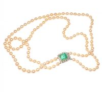 DOUBLE STRING OF SEAWATER PEARLS WITH AN ART DECO STYLE EMERALD & DIAMOND CLASP by Emerald at Ross's Auctions