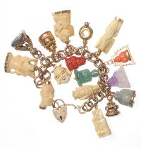 VICTORIAN 9 CT GOLD CHARM BRACELET WITH HEART SHAPED PADLOCK CATCH & SIXTEEN IVORY, CORAL, JADE & GOLD CHARMS by Jade at Ross's Auctions