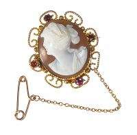 9CT GOLD CAMEO MOURNING BROOCH WITH ALMANDINE GARNETS at Ross's Auctions