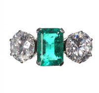 PLATINUM EMERALD AND DIAMOND THREE STONE RING at Ross's Auctions