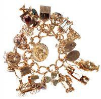9CT GOLD CHARM BRACELET WITH HEART-SHAPED PADLOCK CLASP by Amethyst at Ross's Auctions