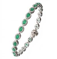 18CT WHITE GOLD EMERALD AND DIAMOND CLUSTER BRACELET by Emerald at Ross's Auctions