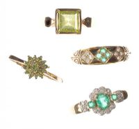 ASSORTED 9CT GOLD EMERALD, PERIDOT AND DIAMOND RINGS OF VARIOUS SIZES (FOUR IN NUMBER) by Peridot at Ross's Auctions