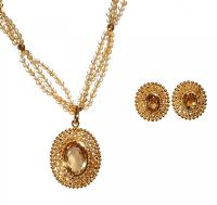A SUITE OF 22CT GOLD AND CITRINE TRIPLE STRAND PENDANT NECKLACE AND EARRINGS by Citrine at Ross's Auctions