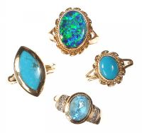 ASSORTED 9CT GOLD TURQUOISE, OPAL DOUBLET AND TOPAZ RINGS OF VARIOUS SIZES (FOUR IN NUMBER) by Turquoise at Ross's Auctions