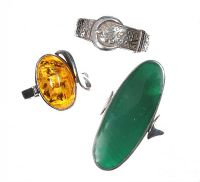 SELECTION OF THREE SILVER RINGS, ONE SET WITH AMBER AND ONE SET WITH MALACHITE at Ross's Jewellery Auctions