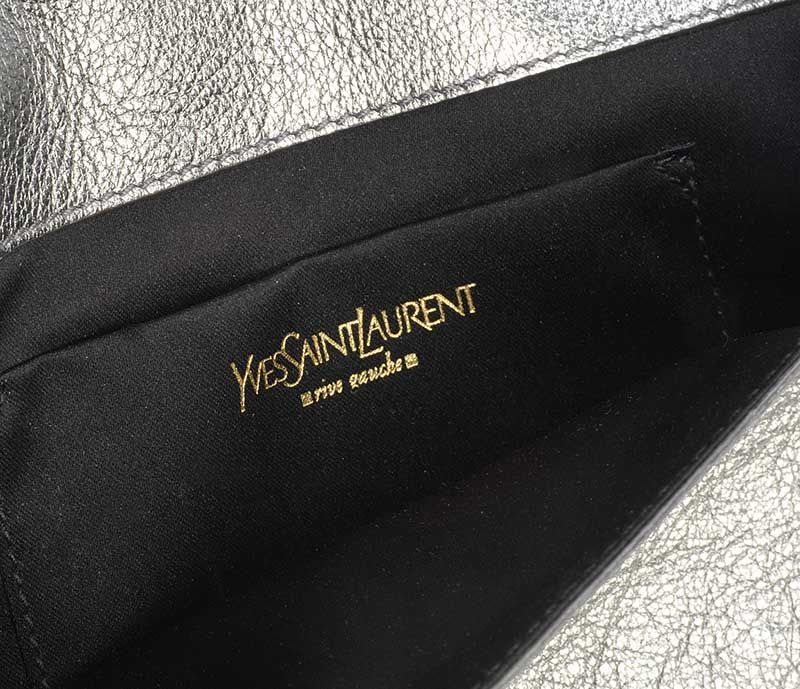 7780b3622de0 ... VINTAGE 1980 S YSL CLUTCH BAG IN METALLIC SILVER LEATHER at Ross s  Online Art Auctions ...