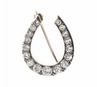 9CT GOLD AND DIAMOND HORSE SHOE BROOCH at Ross's Auctions