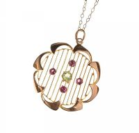 9CT GOLD PERIDOT AND ALMANDINE GARNET SET PENDANT AND CHAIN by Peridot at Ross's Auctions