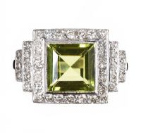 18CT WHITE GOLD PERIDOT AND DIAMOND CLUSTER RING by Peridot at Ross's Auctions