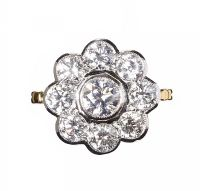 18CT GOLD AND DIAMOND DAISY CLUSTER RING at Ross's Auctions