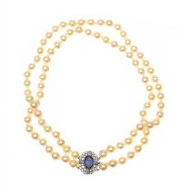 DOUBLE STRAND OF CULTURED PEARLS SET WITH A SAPPHIRE AND DIAMOND CLASP at Ross's Auctions