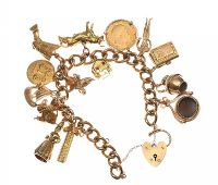 HEAVY 9CT GOLD CHARM BRACELET at Ross's Auctions