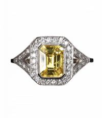 PLATINUM FANCY YELLOW SAPPHIRE AND DIAMOND CLUSTER RING IN THE STYLE OF ART DECO at Ross's Auctions