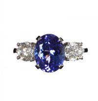 PLATINUM TANZANITE AND DIAMOND THREE STONE RING at Ross's Auctions