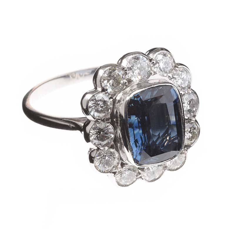 18CT WHITE GOLD SAPPHIRE AND DIAMOND CLUSTER RING at Ross's Online Art Auctions