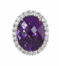 18CT WHITE GOLD COCKTAIL RING SET WITH AMETHYST AND DIAMOND by Amethyst at Ross's Auctions