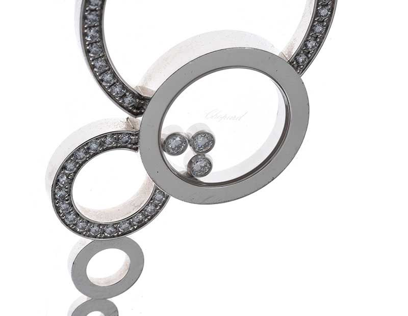 CHOPARD 18CT WHITE GOLD AND DIAMOND 'HAPPY DIAMONDS' PENDANT AND CHAIN at Ross's Online Art Auctions