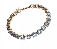 GOLD-PLATED STERLING SILVER BRACELET SET WITH BLUE TOPAZ at Ross's Jewellery Auctions