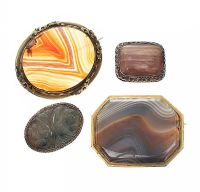 FOUR HARDSTONE-SET BROOCHES at Ross's Jewellery Auctions