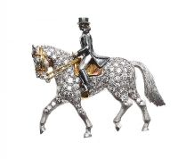 18CT WHITE GOLD 'HORSE AND RIDER' BROOCH SET WITH DIAMONDS at Ross's Online Art Auctions