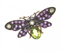 SILVER GILT BUTTERFLY BROOCH SET WITH AMETHYST AND PERIDOT by Peridot at Ross's Auctions