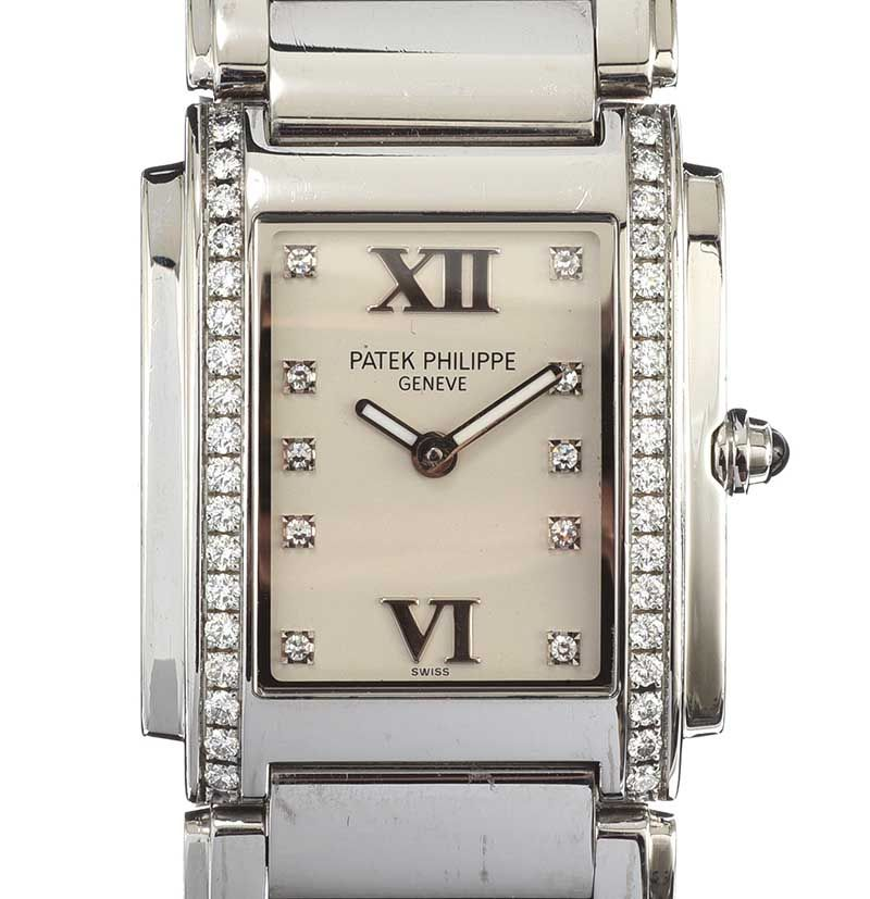 PATEK PHILIPPE DIAMOND-SET STAINLESS STEEL LADY'S WRIST WATCH at Ross's Online Art Auctions