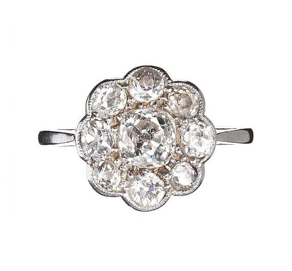 PLATINUM AND DIAMOND ANTIQUE DAISY CLUSTER RING at Ross's Online Art Auctions