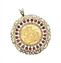 9CT GOLD MOUNTED FULL SOVEREIGN WITH GARNETS at Ross's Jewellery Auctions