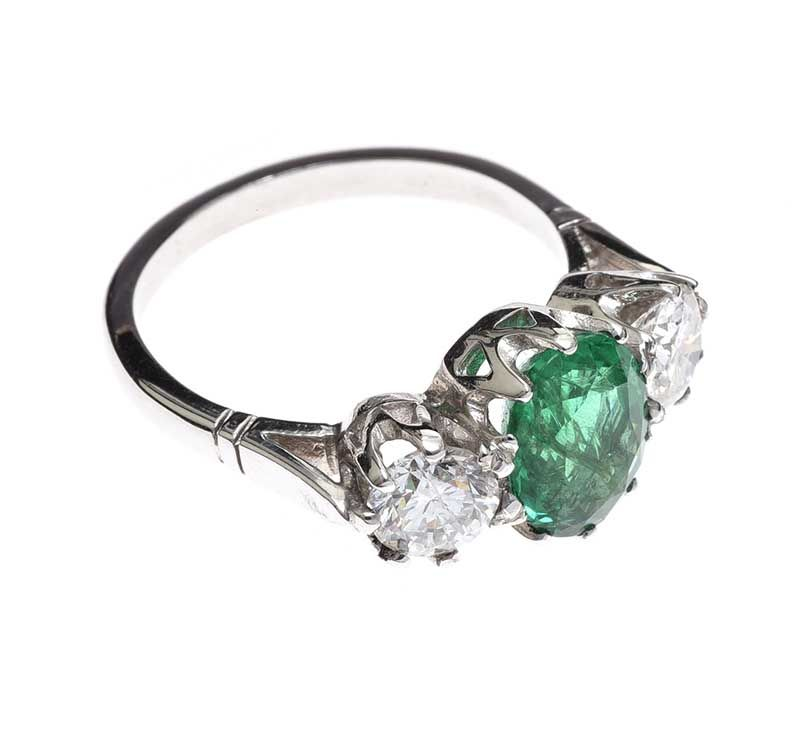 18CT WHITE GOLD EMERALD AND DIAMOND RING at Ross's Online Art Auctions