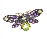 SILVER GILT PERIDOT, AMETHYST AND DIAMOND BROOCH by Peridot at Ross's Auctions