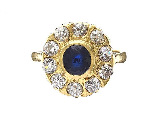 18CT GOLD SAPPHIRE AND DIAMOND CLUSTER RING at Ross's Online Art Auctions