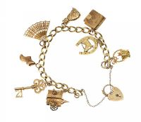 9CT GOLD CHARM BRACELET AND A LOOSE CHARM at Ross's Auctions