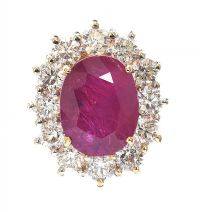 18CT GOLD RUBY AND DIAMOND CLUSTER RING at Ross's Auctions
