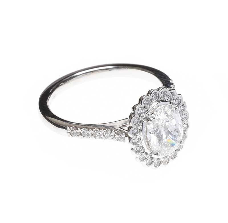 PLATINUM DIAMOND HALO CLUSTER RING at Ross's Online Art Auctions