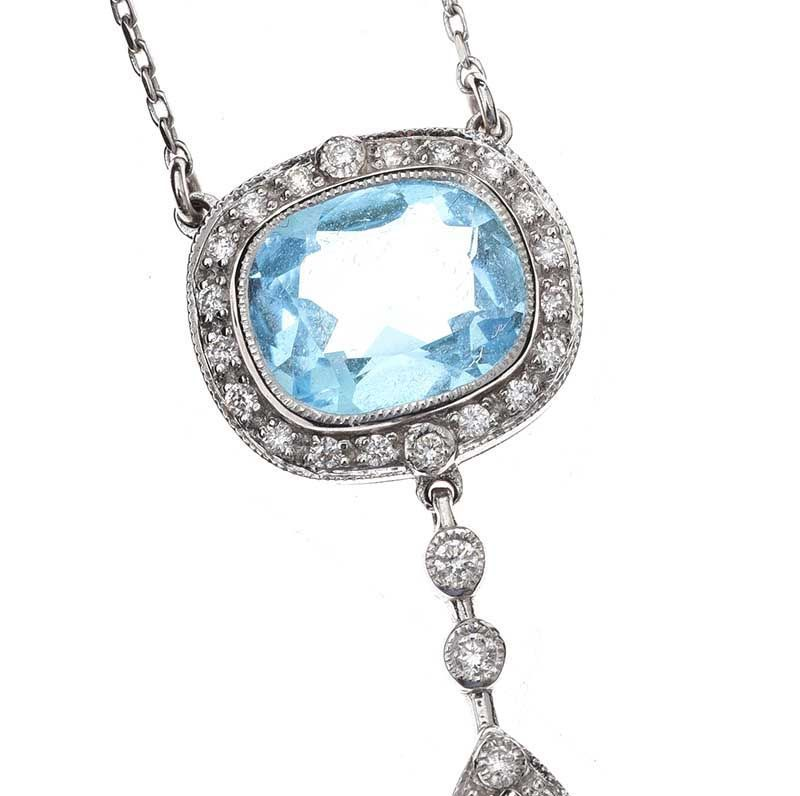 18CT WHITE GOLD BLUE TOPAZ AND DIAMOND PENDANT at Ross's Online Art Auctions