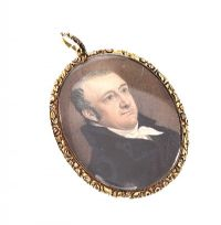 GEORGIAN MINIATURE PORTRAIT PENDANT WITH DECORATIVE GILT FRAME at Ross's Auctions