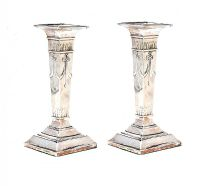 TWO VERY SIMILAR ANTIQUE STERLING SILVER CANDLESTICKS at Ross's Auctions