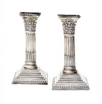 PAIR OF EDWARDIAN STERLING SILVER CORINTHIAN CANDLESTICKS at Ross's Online Art Auctions