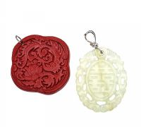 TWO CARVED PENDANTS at Ross's Jewellery Auctions