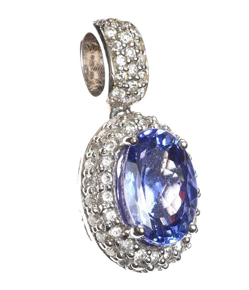 18CT WHITE GOLD TANZANITE AND DIAMOND PENDANT at Ross's Online Art Auctions