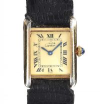CARTIER 'TANK' SILVER GILT TANK WRIST WATCH at Ross's Auctions