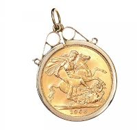 9CT GOLD MOUNTED SOVEREGIN at Ross's Auctions
