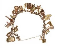 9CT GOLD CHARM BRACELET at Ross's Auctions