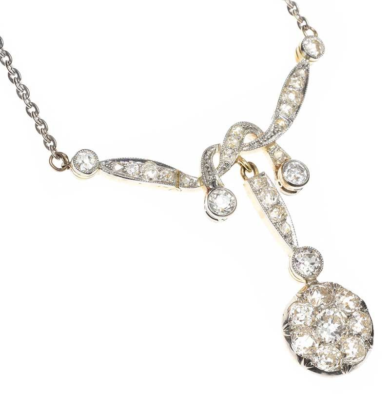 ART DECO PLATINUM AND GOLD DIAMOND NECKLACE at Ross's Online Art Auctions