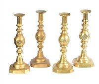 SET OF FOUR BRASS CANDLESTICKS at Ross's Auctions