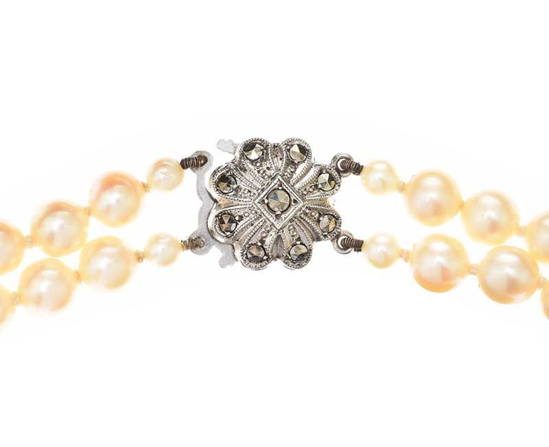 DOUBLE STRAND OF CULTURED PEARLS WITH MARCASITE-SET SILVER CLASP at Ross's Online Art Auctions