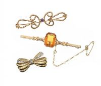 THREE 9CT GOLD BROOCHES at Ross's Jewellery Auctions